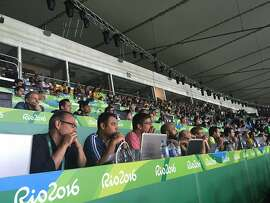 Journalists look on at Brazil-Germany gold medal soccer game