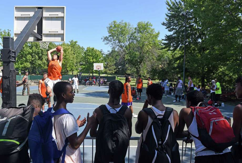 Players compete in the 14th annual Joyce E. King Memorial Basketball tournament at Arbor Hill Park on Saturday Aug. 20, 2016 in Albany, N.Y. (Michael P. Farrell/Times Union) Photo: Michael P. Farrell / 20037737A