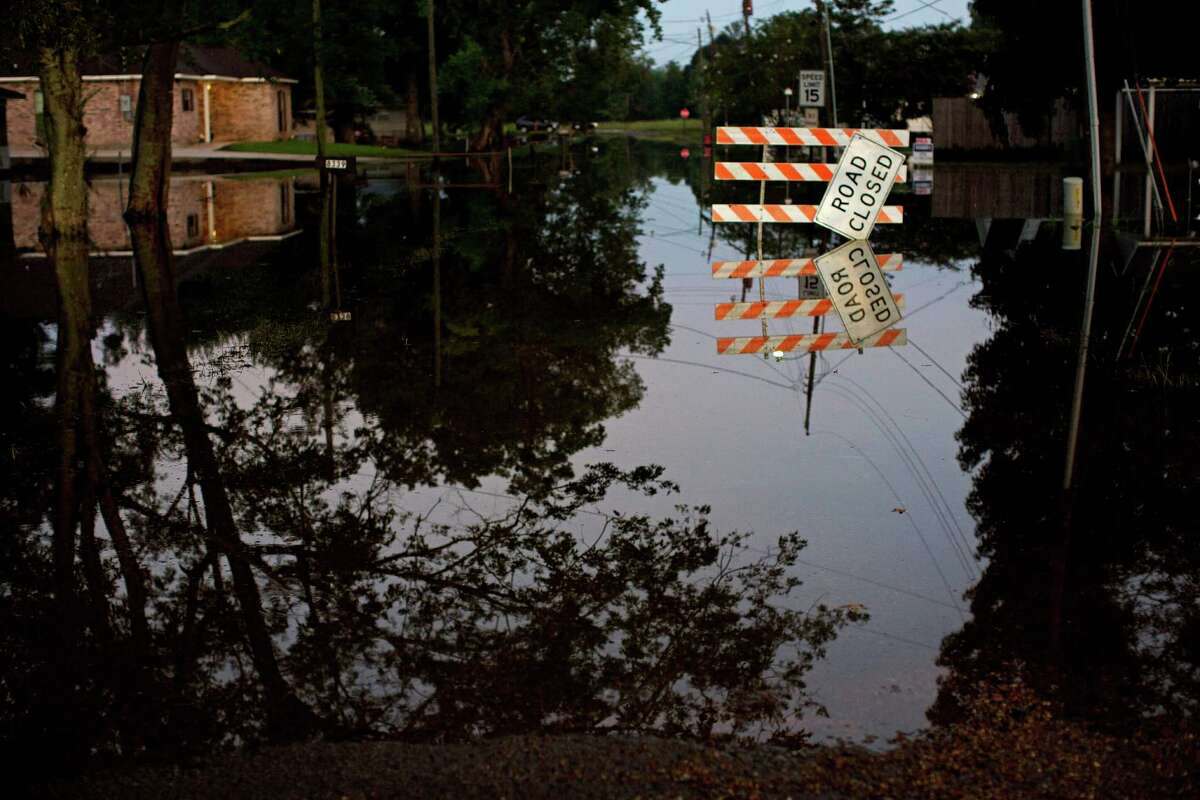 Standing water closes roads in Sorrento, La., Saturday, Aug. 20, 2016. Louisiana continues to dig itself out from devastating floods, with search parties going door to door looking for survivors or bodies trapped by flooding. (AP Photo/Max Becherer)