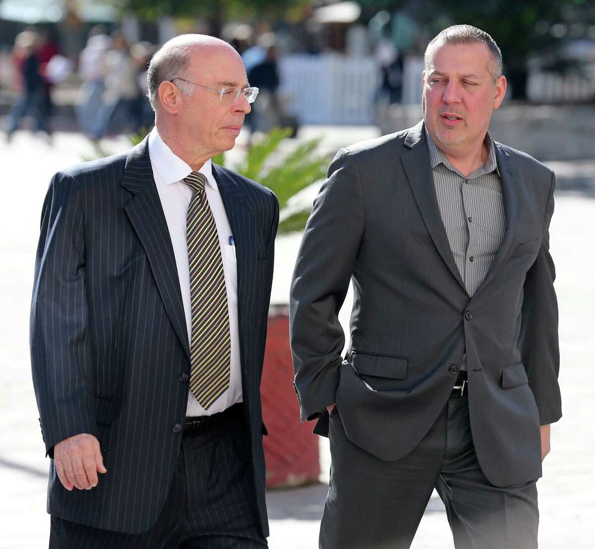 """Attorney Martin Seidler (left) and Stan Bates walk into the Hipolito F. Garcia Federal Building to attend a bankruptcy court hearing. Bates, who was majority owner of San Antonio frac sand company FourWinds Logistics, has been accused of using investor money to support a """"wild lifestyle,"""" according to a court document. Bates has disputed the allegation."""