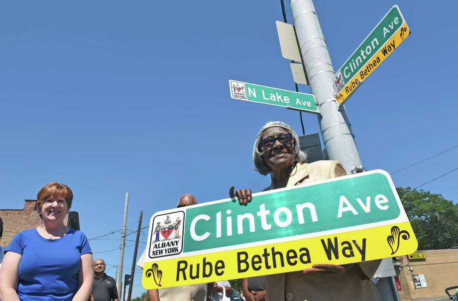 "Mayor Kathy Sheehan presented 101 year-old Alice Olivia Bethea wife of Bishop Rube Bethea with a duplicate street sign during a dedication ceremony naming the section of Clinton Avenue (between N. Lake and Quail Street) ""Rube Bethea Way"" in honor of our previous pastor Bishop Rube Bethea, (died in 2005) as part of the Church of Jesus Christ Community Day on Saturday Aug. 20, 2016 in Albany, N.Y. (Michael P. Farrell/Times Union) Photo: Michael P. Farrell / 20037721A"