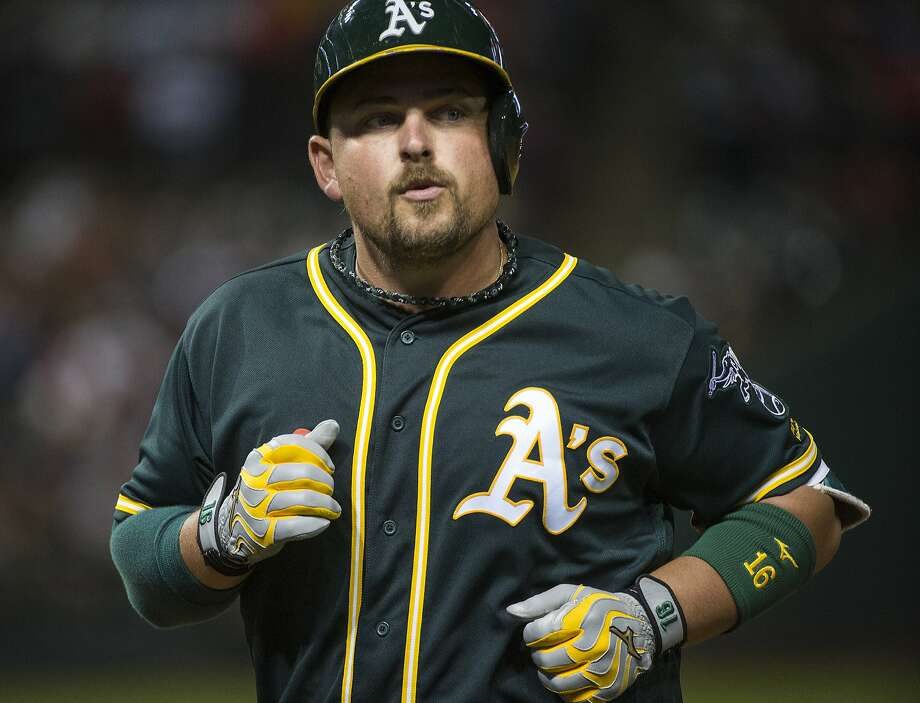 Oakland Athletics' Billy Butler heads back to the dugout after flying out against the Cleveland Indians during the ninth inning of a baseball game in Cleveland, Saturday, July 30, 2016. (AP Photo/Phil Long) Photo: Phil Long, Associated Press