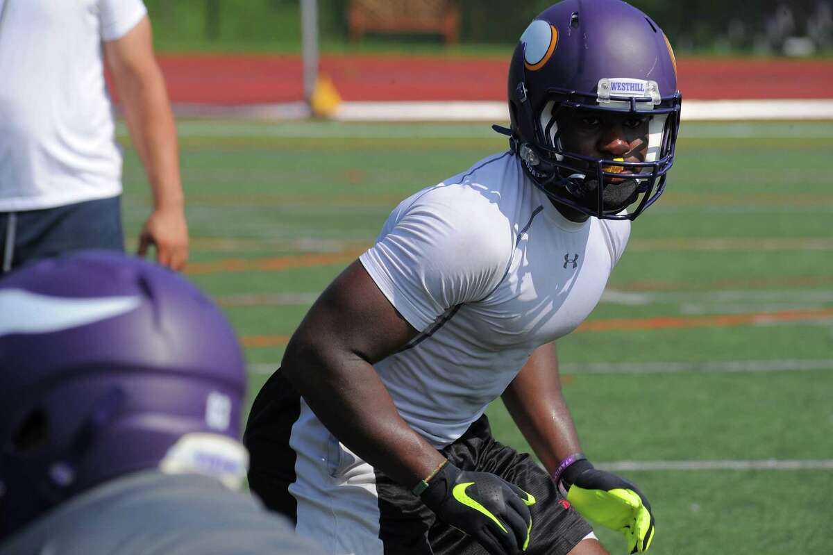 Westhill linebacker Mekhi Barnett looks over the offense during a team practice on Saturday, Aug. 20, 2016 at the high school in Stamford.