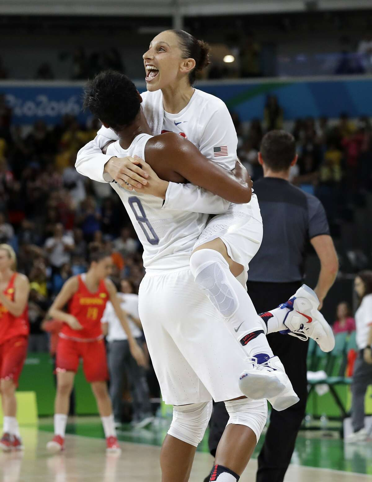 United States' Diana Taurasi, right, leaps into the arms of teammate Angel McCoughtry as they celebrate their win over Spain in a women's gold medal basketball game at the 2016 Summer Olympics in Rio de Janeiro, Brazil, Saturday, Aug. 20, 2016. (AP Photo/Eric Gay)
