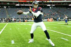 Houston Texans quarterback Brock Osweiler (17) warms up before an NFL pre-season football game against the New Orleans Saints at NRG Stadium on Saturday, Aug. 20, 2016, in Houston.