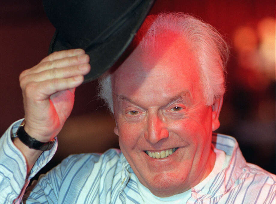 FILE  - In this Dec. 7, 1998 file photo, actor and learning disability campaigner Brian Rix, 92 poses for the camera, in London. A British charity says Brian Rix, a comic actor who used his fame to draw attention to the struggles of people with learning disabilities, has died it was announced on Saturday, Aug. 20, 2016. He was 92 and had been ill for some time. (Abbie Trayler Smith/PA via AP, File)  ORG XMIT: AMB812 Photo: Abbie Trayler Smith / PA