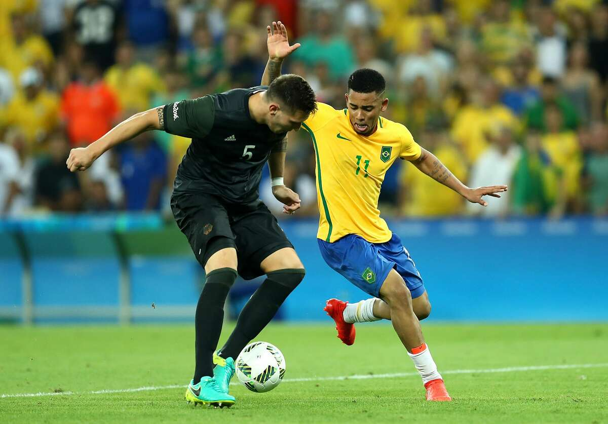 RIO DE JANEIRO, BRAZIL - AUGUST 20: Niklas Suele of Germany and Gabriel Jesus of Brazil during the Men's Football Final between Brazil and Germany at the Maracana Stadium on Day 15 of the Rio 2016 Olympic Games on August 20, 2016 in Rio de Janeiro, Brazil. (Photo by Lars Baron/Getty Images)