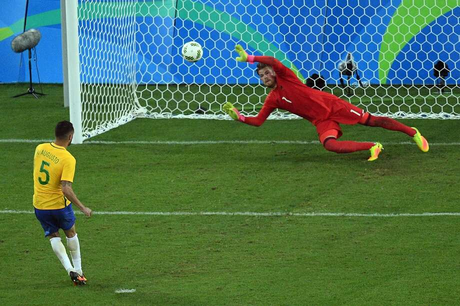 Brazil's forward Neymar scores the winning goal past Germany's goalkeeper Timo Horn during the penalty shoot-out of the Rio 2016 Olympic Games men's football gold medal match between Brazil and Germany at the Maracana stadium in Rio de Janeiro on August 20, 2016.  / AFP PHOTO / Johannes EISELEJOHANNES EISELE/AFP/Getty Images Photo: JOHANNES EISELE, AFP/Getty Images