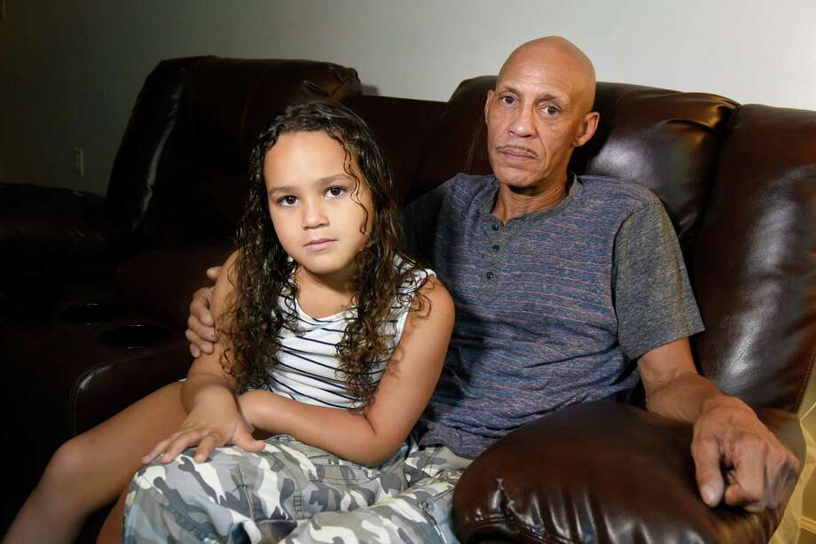Westley Williams with his daughter Giada Williams, 6, on Friday, Aug. 19, 2016, at their home in Troy, N.Y. Westley Williams was serving in the Marines when he was taken hostage in Iran in 1979. (Cindy Schultz / Times Union) Photo: Cindy Schultz / Albany Times Union