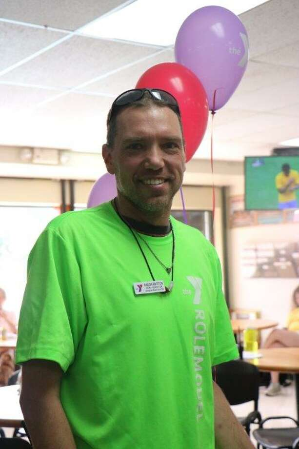 The Wilton Family YMCA honored Aaron Britton on Wednesday, Aug. 17, for his 19-year career. Britton will be retiring from his position as camp director on Friday, Aug. 26. Photo: Contributed Photo