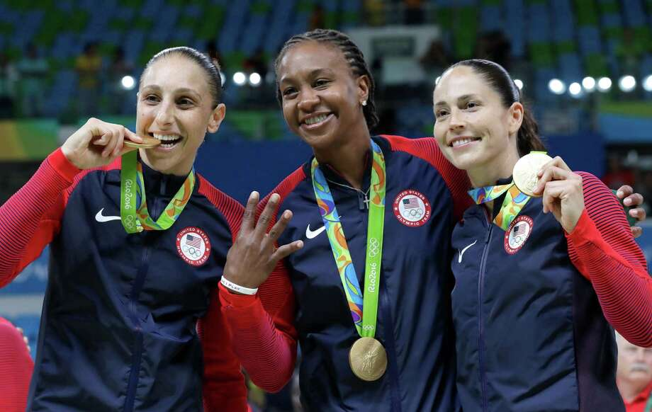 United States' Diana Taurasi, left, Tamika Catchings, center, and Sue Bird, right, celebrate with their gold medals after their win in a women's basketball game against Spain at the 2016 Summer Olympics in Rio de Janeiro, Brazil, Saturday, Aug. 20, 2016. (AP Photo/Eric Gay) ORG XMIT: OBKL236 Photo: Eric Gay / Copyright 2016 The Associated Press. All rights reserved. This m