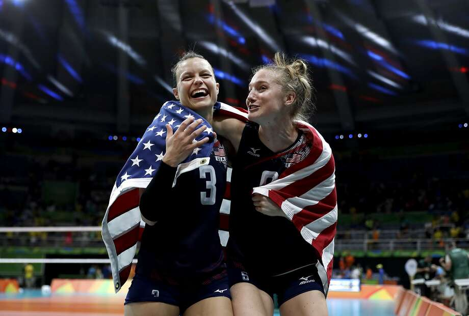 Cal alum Carli Lloyd (right) and Courtney Thompson celebrate the Americans' bronze medal win over in women's volleyball. Photo: Jeff Roberson, Associated Press