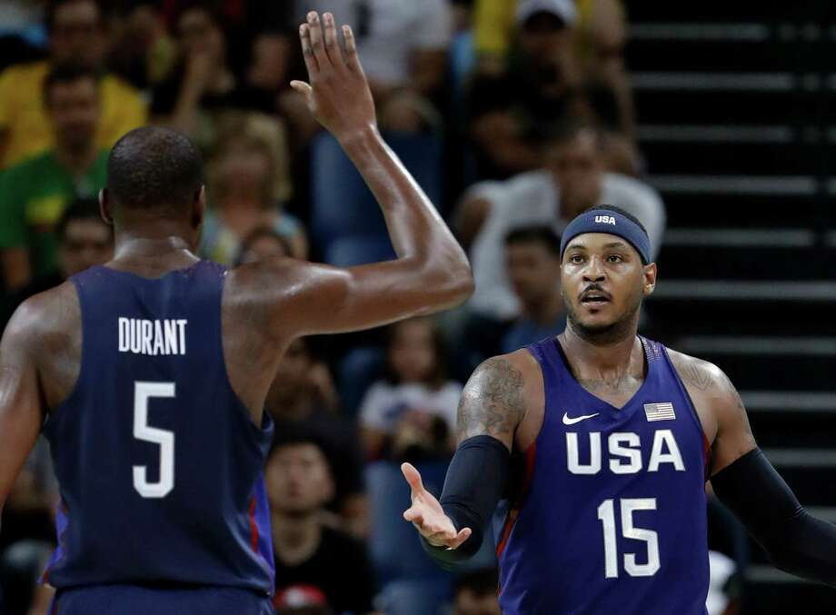 United States' Carmelo Anthony (15) celebrates with teammate Kevin Durant (5) during a men's semifinal round basketball game against Spain at the 2016 Summer Olympics in Rio de Janeiro, Brazil, Friday, Aug. 19, 2016. (AP Photo/Eric Gay) ORG XMIT: OBKO215 Photo: Eric Gay / Copyright 2016 The Associated Press. All rights reserved. This m