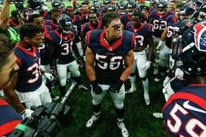Houston Texans inside linebacker Brian Cushing (56) gathers his teammates together before the first quarter of an NFL pre-season football game against the New Orleans Saints at NRG Stadium on Saturday, Aug. 20, 2016, in Houston.