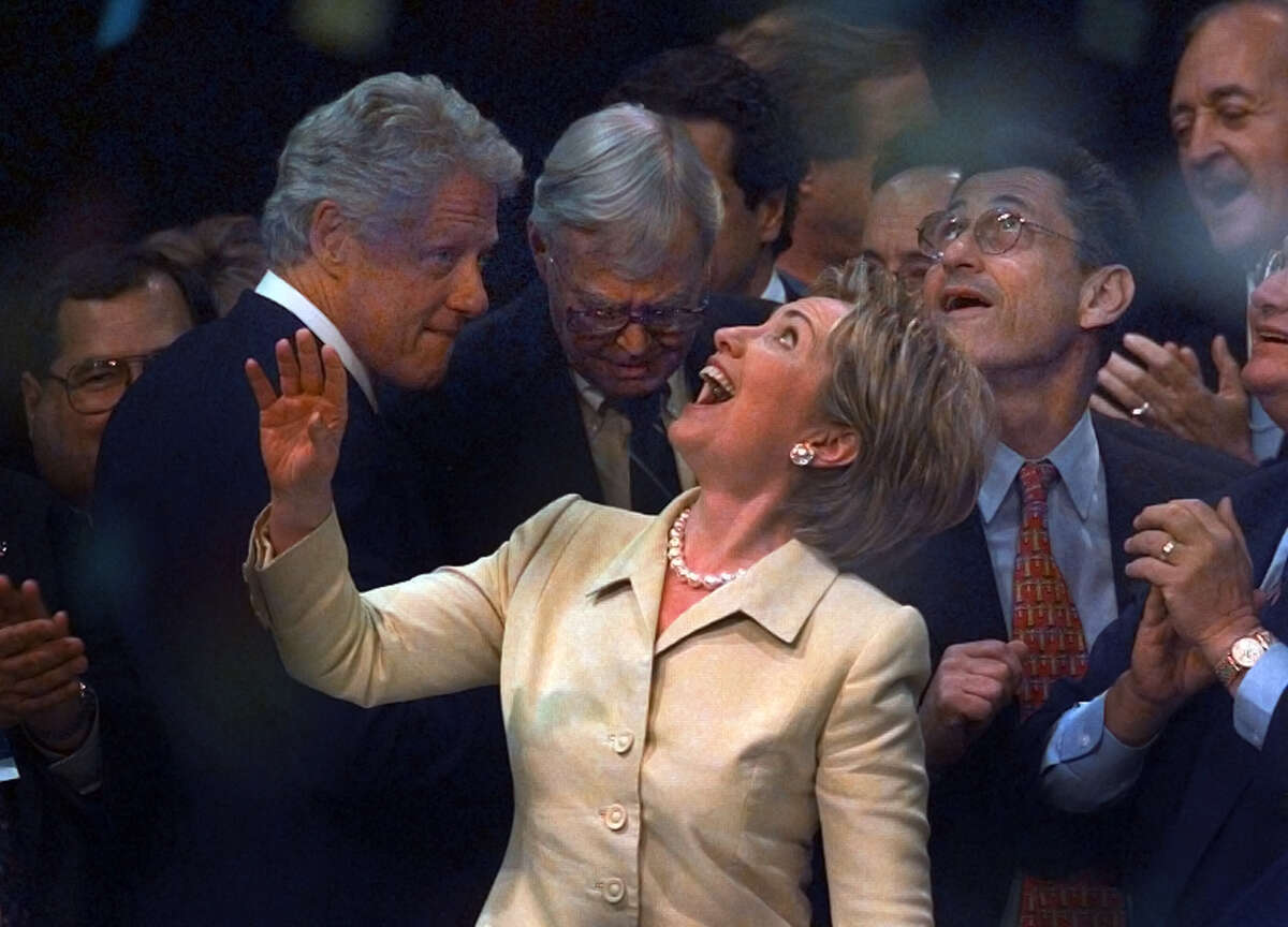 Hillary Clinton celebrates her nomination as Democratic candidate for the US Senate at the state Democratic convention at the Pepsi Arena on Tuesday, May 16, 2000, in Albany, N.Y. At left is her husband, President Bill Clinton, at center is outgoing Senator Patrick Moynihan. At right is state Assembly speaker Sheldon Silver. (Philip Kamrass/Times Union archive)