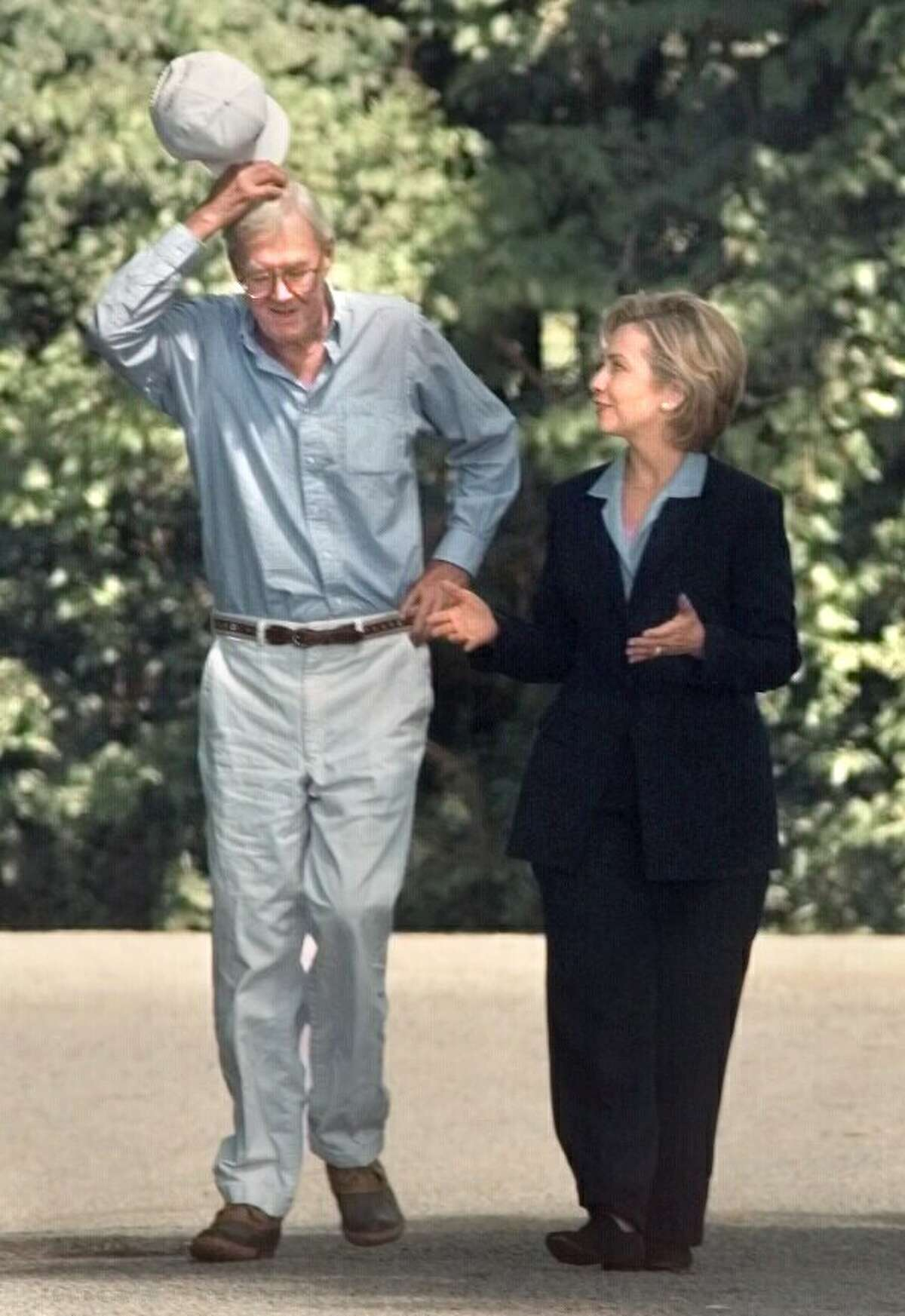 Retiring U.S. Senator Danial Patrick Moynihan talks with First Lady Hillary Clinton during a walk around the grounds of his summer home on Wednesday, July 7, 1999, in Davenport, N.Y. (Michael P. Farrell/Times Union archive)