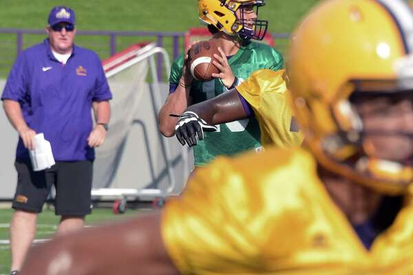 UAlbany football quarterback Neven Sussman runs a play as Head Coach Greg Gattuso looks on during practice at Casey Stadium Saturday Aug. 13, 2016 in Albany, NY.  (John Carl D'Annibale / Times Union)