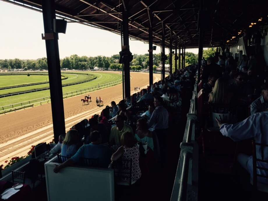 The tables were full in the Turf Terrace on Alabama Day at the Spa on Saturday. And what a nice day for it! The horses are here on the track for the start of the second race on the 12-race card. In a week, it will be Travers Day and here's a sure bet: you won't be able to get a table in the Terrace.  —Tim Wilkin