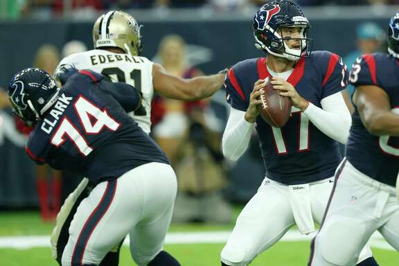 Houston Texans quarterback Brock Osweiler (17) dros back to pass against the New Orleans Saints during the first quarter of an NFL pre-season football game at NRG Stadium on Saturday, Aug. 20, 2016, in Houston.