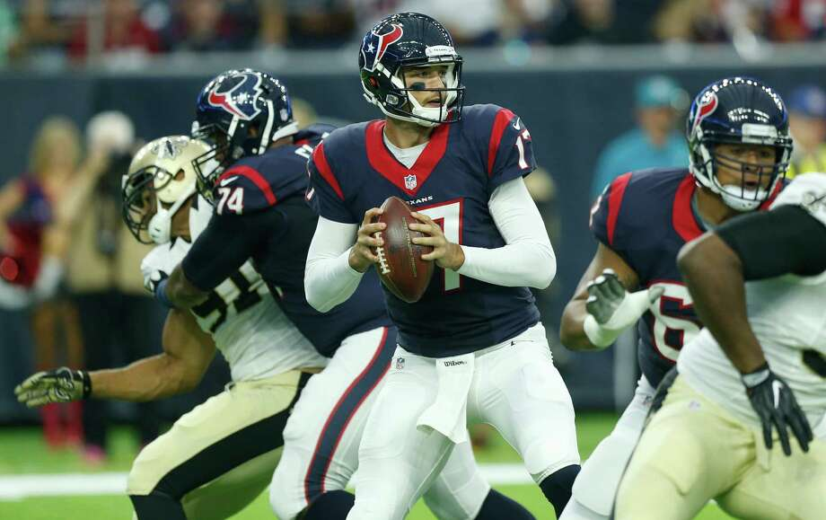Houston Texans quarterback Brock Osweiler (17) dros back to pass against the New Orleans Saints during the first quarter of an NFL pre-season football game at NRG Stadium on Saturday, Aug. 20, 2016, in Houston. Photo: Brett Coomer, Houston Chronicle / © 2016 Houston Chronicle