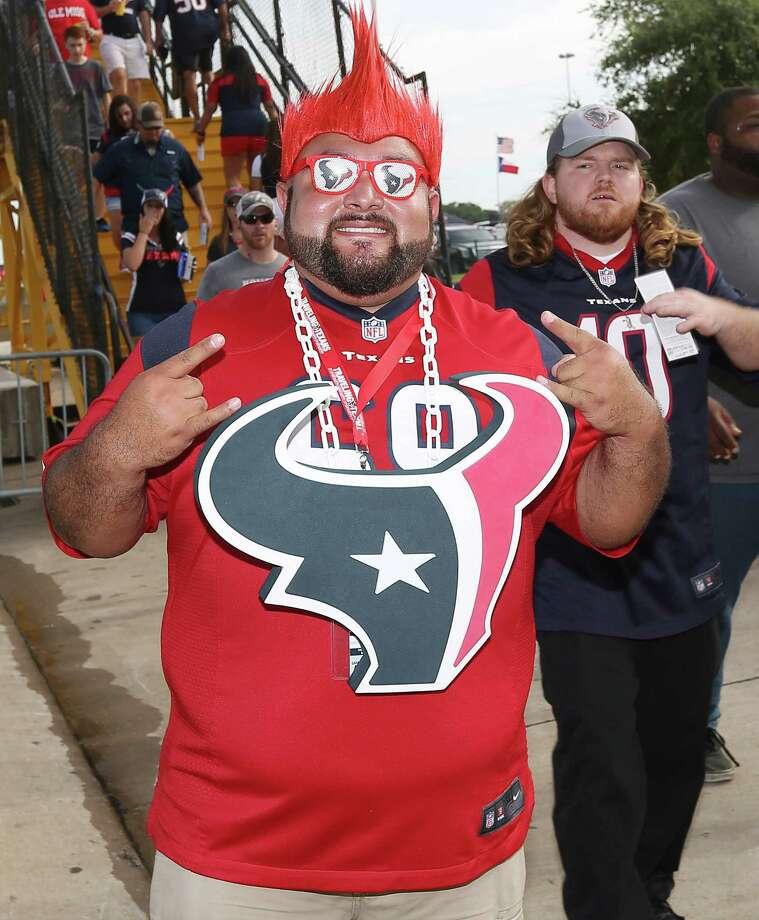 People pose for a photo at the Houston Texans preseason game against the New Orleans Saints, Saturday, Aug. 20, 2016, in Houston. Photo: Jon Shapley, Houston Chronicle / © 2016  Houston Chronicle
