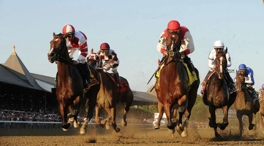 Songbird, far left,  passes the clubhouse for the first time on the way to a resounding win in the 136th running of the Alabama Stakes at the Saratoga Race Course August 20, 2016 in Saratoga Springs, N.Y.    (Skip Dickstein/Times Union) Photo: SKIP DICKSTEIN
