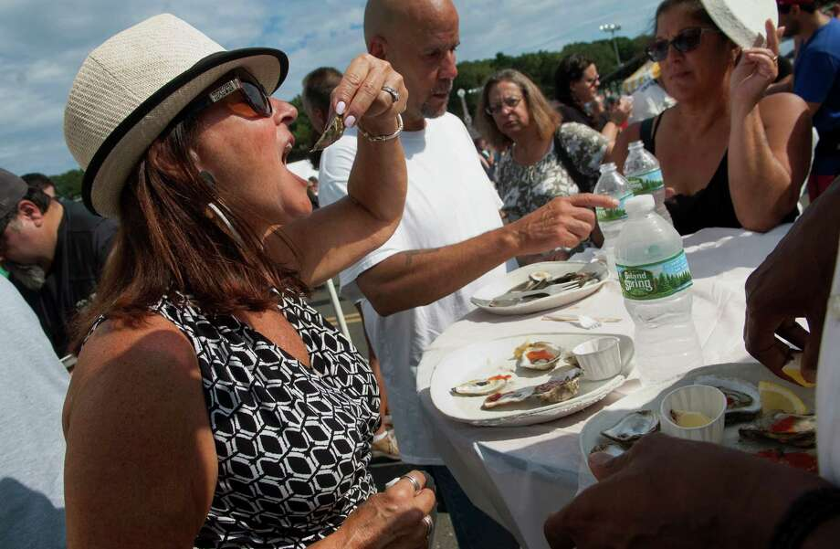 Bonnie Wilson, of Southbury, eats some oysters at the 42nd Annual Milford Oyster Festival in downtown Milford, Conn., on Saturday Aug. 21, 2016. Some of the activities included the Marshall Tucker Band, which headlined the musical events at Fowler Field. National act Blue Oyster Cult also performed. There were amusement rides, a dunk tank, arts & crafts, a car and motorcycle show and the most variety of oysters from eight states. Photo: Christian Abraham / Hearst Connecticut Media / Connecticut Post
