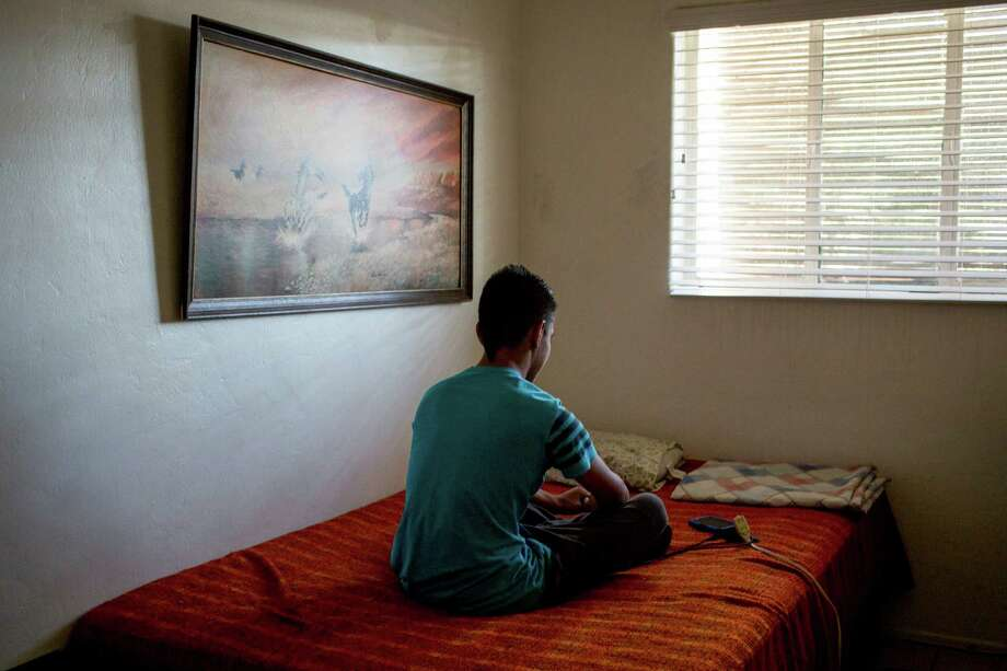 A 15-year-old boy is asking for asylum in Arizona after fleeing gang violence in El Salvador, but he did not have a lawyer in immigration court.  Photo: CAITLIN OHARA, STR / NYTNS