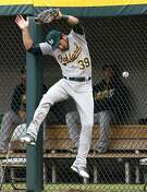 Oakland Athletics right fielder Brett Eibner can't make the play on a solo home run by Chicago White Sox's Jose Abreu during the first inning of a baseball game in Chicago, Saturday, Aug. 20, 2016. (AP Photo/Nam Y. Huh)
