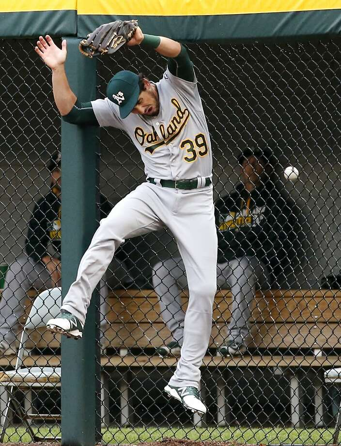 Oakland Athletics right fielder Brett Eibner can't make the play on a solo home run by Chicago White Sox's Jose Abreu during the first inning of a baseball game in Chicago, Saturday, Aug. 20, 2016. (AP Photo/Nam Y. Huh) Photo: Nam Y. Huh, Associated Press
