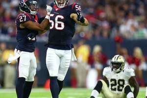 Houston Texans inside linebacker Brian Cushing (56) and strong safety Quintin Demps (27) celebrate Cushing breaking up a pass intended for New Orleans Saints running back C.J. Spiller (28) during the first quarter of an NFL game at NRG Stadium, Saturday, Aug. 20, {year}, in Houston.