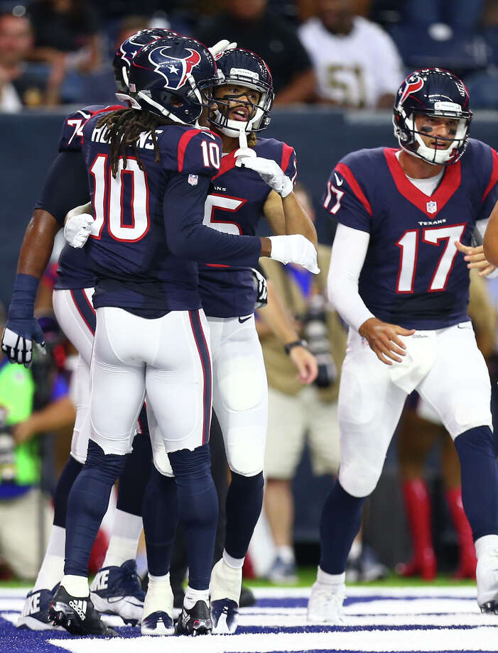 Houston Texans wide receiver DeAndre Hopkins (10) embraces Houston Texans wide receiver Will Fuller (15) to celebrate Fuller's 19-yard touchdown reception against the New Orleans Saints during the first quarter of an NFL game at NRG Stadium, Saturday, Aug. 20, {year}, in Houston. Photo: Karen Warren, Houston Chronicle / 2016 Houston Chronicle
