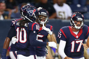 Houston Texans wide receiver DeAndre Hopkins (10) embraces Houston Texans wide receiver Will Fuller (15) to celebrate Fuller's 19-yard touchdown reception against the New Orleans Saints during the first quarter of an NFL game at NRG Stadium, Saturday, Aug. 20, {year}, in Houston.