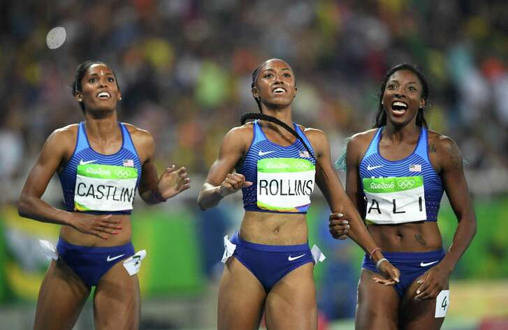 Winner Brianna Rollins, center, celebrates with runnerup Nia Ali, right, and third-place finisher Kristi Castlin after they crossed the finish line to complete a U.S. sweep of the 100-meter hurdles. (Johannes Eisele /AfP/ Getty Images)