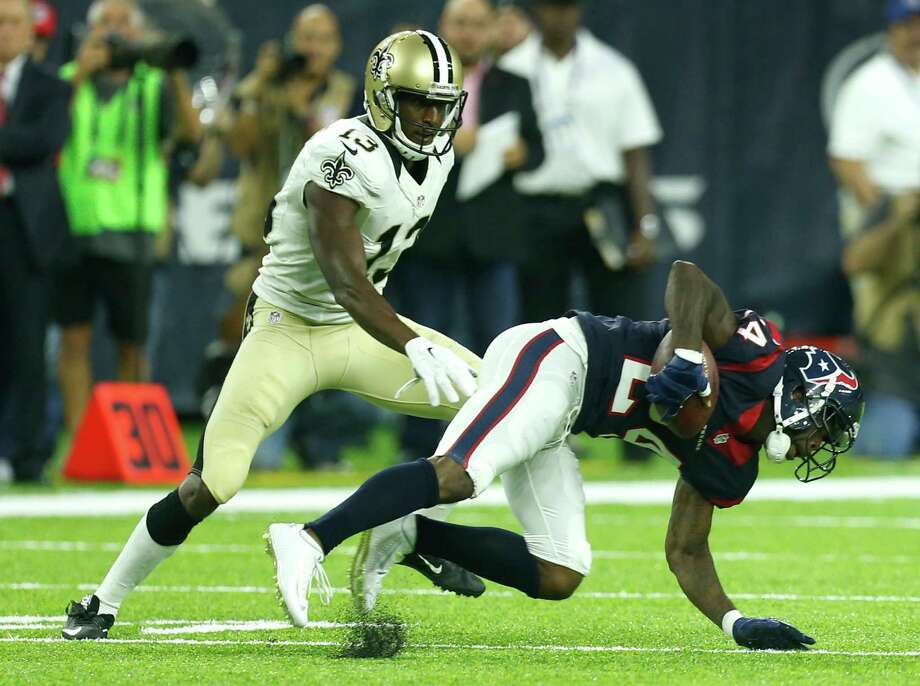 Houston Texans cornerback Johnathan Joseph (24) intercepts a pass intended for New Orleans Saints wide receiver Michael Thomas (13) during the first quarter of an NFL pre-season football game at NRG Stadium on Saturday, Aug. 20, 2016, in Houston. Photo: Brett Coomer, Houston Chronicle / © 2016 Houston Chronicle