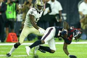 Houston Texans cornerback Johnathan Joseph (24) intercepts a pass intended for New Orleans Saints wide receiver Michael Thomas (13) during the first quarter of an NFL pre-season football game at NRG Stadium on Saturday, Aug. 20, 2016, in Houston.