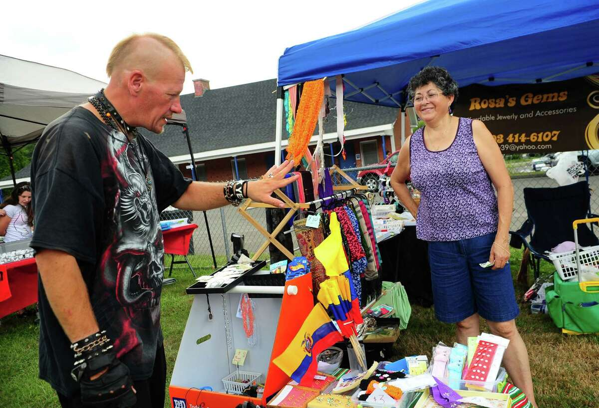 Ronnie Bergeron, of Ansonia, sees how a ring he bought looks while enjoying Rock The Valley: A Day of Music Art & Fun held at Nolan Field in Ansonia, Conn., on Saturday Aug. 20, 2016. Musical lineup included Kathy Thompson Band, All Funk'd Up, 1980's Glam band XYZ (Revisited) and Quicksand Planet supporting our internationally acclaimed, the one and only, cast of Beatlemania as well as a wide variety of Artisans, Crafters and Vendors of all types, great foods, a beer garden, a Kid's Zone and much more!