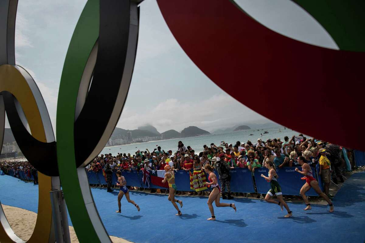 Akin to cities that pursue the Games, Olympians such as those in Saturday's women's triathlon couldn't be faulted for wanting to run rings around the competition.