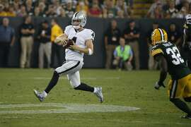 Oakland Raiders quarterback Derek Carr (4) runs against the Green Bay Packers during the first half of an NFL preseason football game in Green Bay, Wis., Thursday, Aug. 18, 2016. (AP Photo/Mike Roemer)