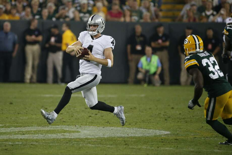 Derek Carr ran for a 16-yard gain against the Green Bay Packers in Thursday's preseason contest — until the play was called back due to offensive holding. Photo: Mike Roemer, Associated Press