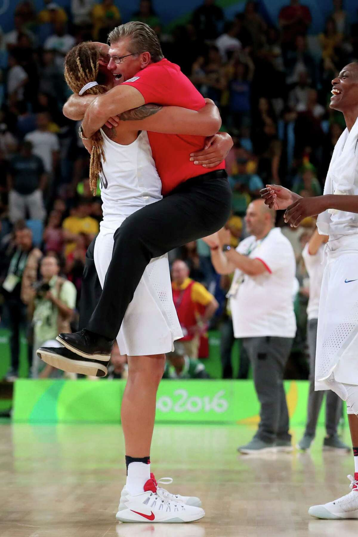 Brittney Griner, left, and U.S. coach Geno Auriemma celebrated another gold medal with a 101-72 drubbing over Spain.