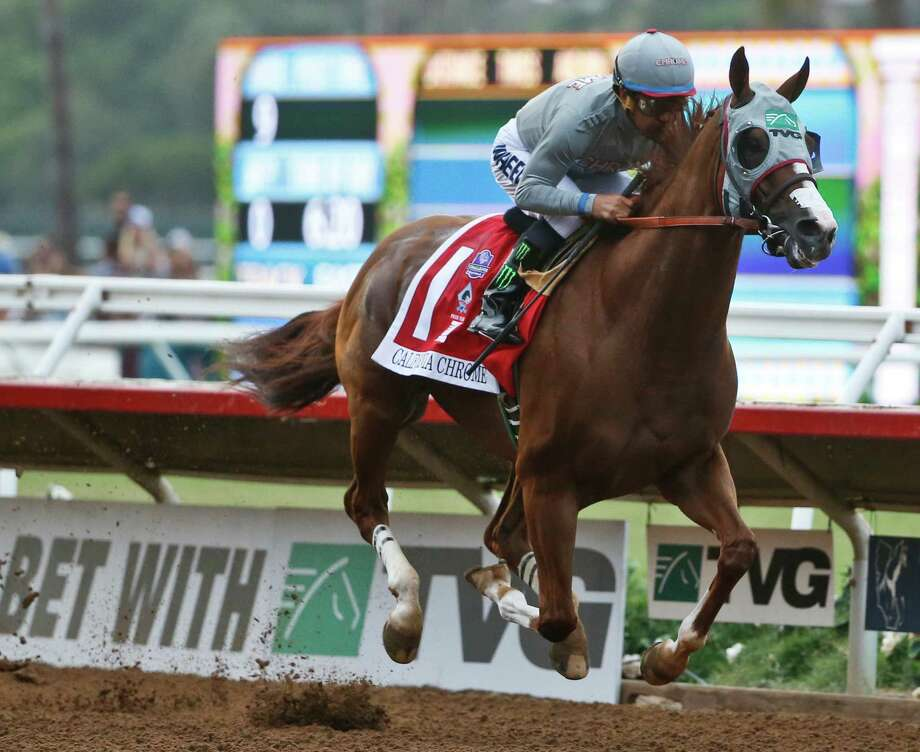 California Chrome flies down the opening stretch during the running of the Pacific Classic at Del Mar Thoroughbred Club, Saturday, Aug. 20, 2016, in Del Mar, Calif. (AP Photo/Lenny Ignelzi) ORG XMIT: CALI104 Photo: Lenny Ignelzi / Copyright 2016 The Associated Press. All rights reserved. This m