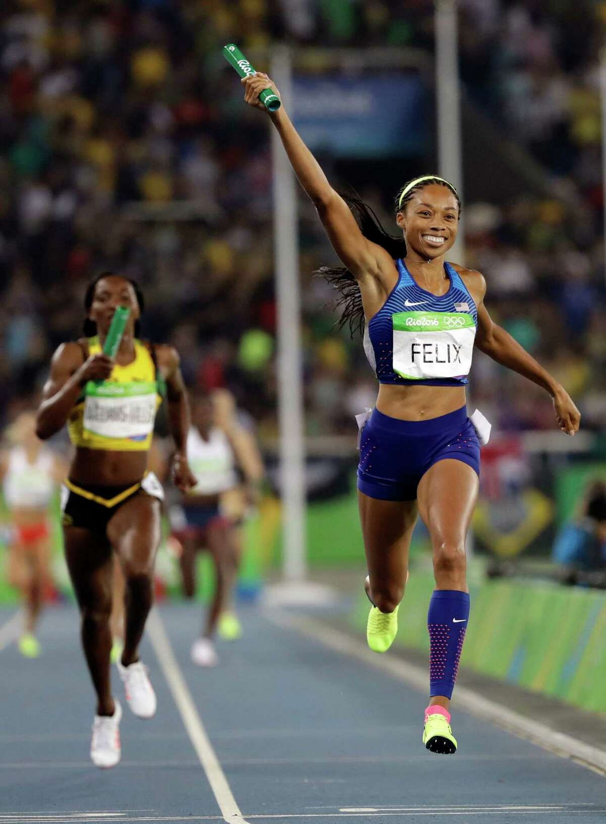 United States' Allyson Felix crosses the line to win the gold medal in the women's 1,600-meter relay Saturday on the final night of events at Olympic Stadium in Rio de Janeiro.