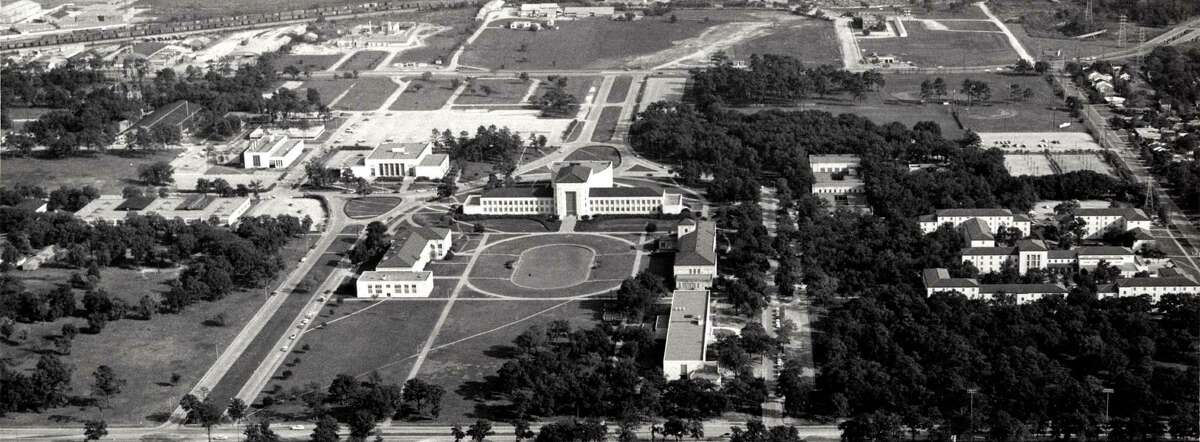 1958 - Aerial view of University of Houston campus highlighting the Ezekiel Cullen building and Cullen Family Plaza. In 1936, the University of Houston acquired nearly 110 acres for a permanent campus from donations from Ben Taub and the Settegast estate. The school began holding classes on this new campus, located east of downtown, in 1939. credit: Special Collections, University of Houston Libraries