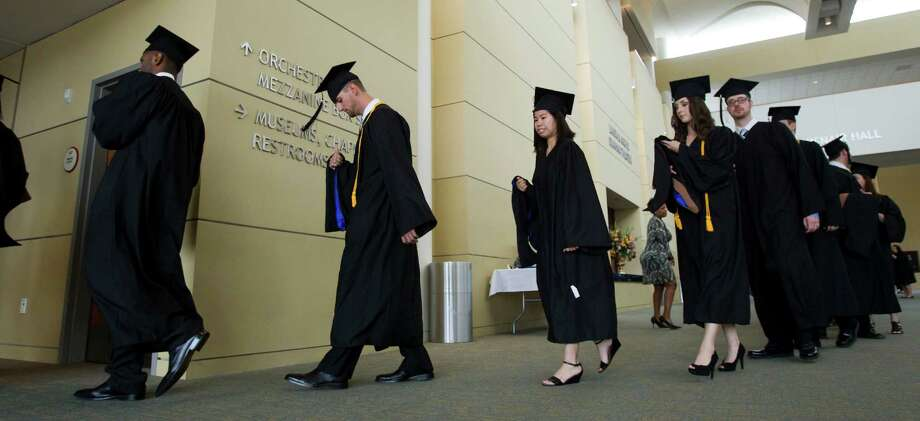 Houston Baptist University graduates line up for their graduation during commencement exercises at HBU Saturday, May 8, 2010, in Houston. Click through to see how college tuition has changed on campuses around the state. Photo: Brett Coomer, Staff / Houston Chronicle