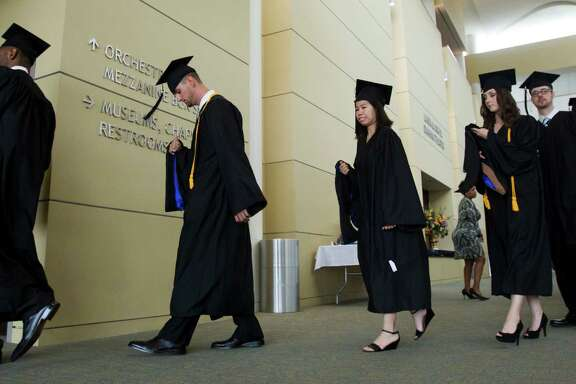 Houston Baptist University graduates line up for their graduation during commencement exercises at HBU Saturday, May 8, 2010, in Houston. ( Brett Coomer / Houston Chronicle )