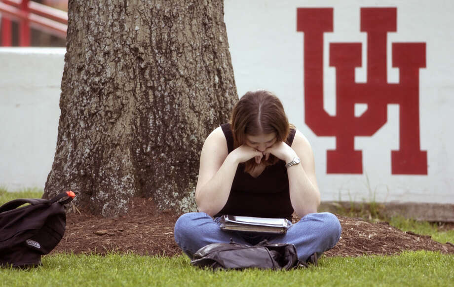 "Allison Husband (freshman, business major) studies in Lynn Eusan park on campus at the University of Houston, Thursday afternoon, April 4, 2002.   The University will celebrate its 75th anniversary this month, highlighted by special activities during ""Cougar Pride Week"" which begins Monday (Apr. 8).  From its humble beginnings as the Houston Junior College, established in 1927, today  the university serves over 33,000 students.  (Smiley N. Pool/Chronicle)  04/04/02 Photo: SMILEY N. POOL, STAFF / HOUSTON CHRONICLE"