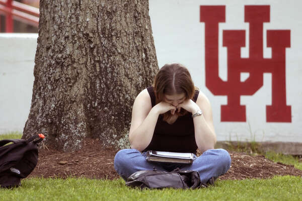 "Allison Husband (freshman, business major) studies in Lynn Eusan park on campus at the University of Houston, Thursday afternoon, April 4, 2002.   The University will celebrate its 75th anniversary this month, highlighted by special activities during ""Cougar Pride Week"" which begins Monday (Apr. 8).  From its humble beginnings as the Houston Junior College, established in 1927, today  the university serves over 33,000 students.  (Smiley N. Pool/Chronicle)  04/04/02"