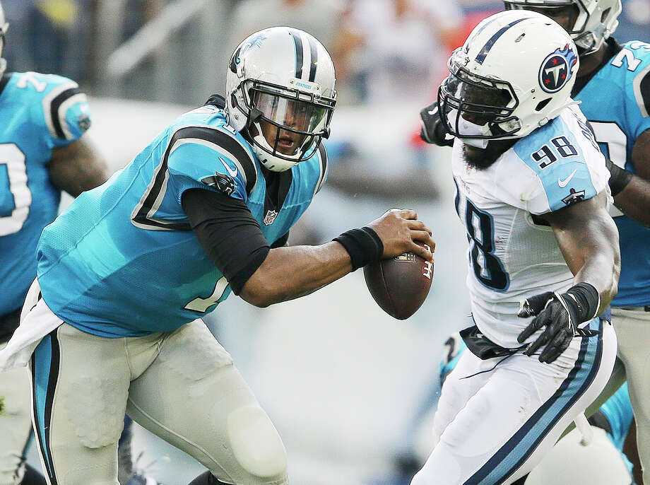 Tennessee Titans outside linebacker Brian Orakpo (98) chases Carolina Panthers quarterback Cam Newton (1) the first half of an NFL preseason football game, Saturday, Aug. 20, 2016, in Nashville, Tenn. (AP Photo/James Kenney) ORG XMIT: TNMS108 Photo: James Kenney / FR171271 AP