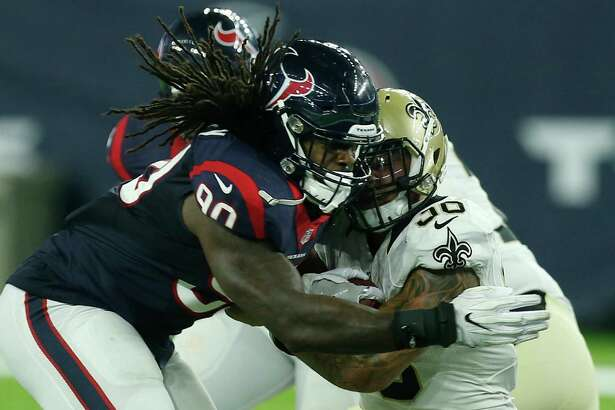 Houston Texans outside linebacker Jadeveon Clowney (90) hits New Orleans Saints running back Daniel Lasco (36) at the line of scrimmage during the third quarter of an NFL pre-season football game at NRG Stadium on Saturday, Aug. 20, 2016, in Houston.